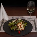 Grilled haloumi cheese with salads and fried seeds