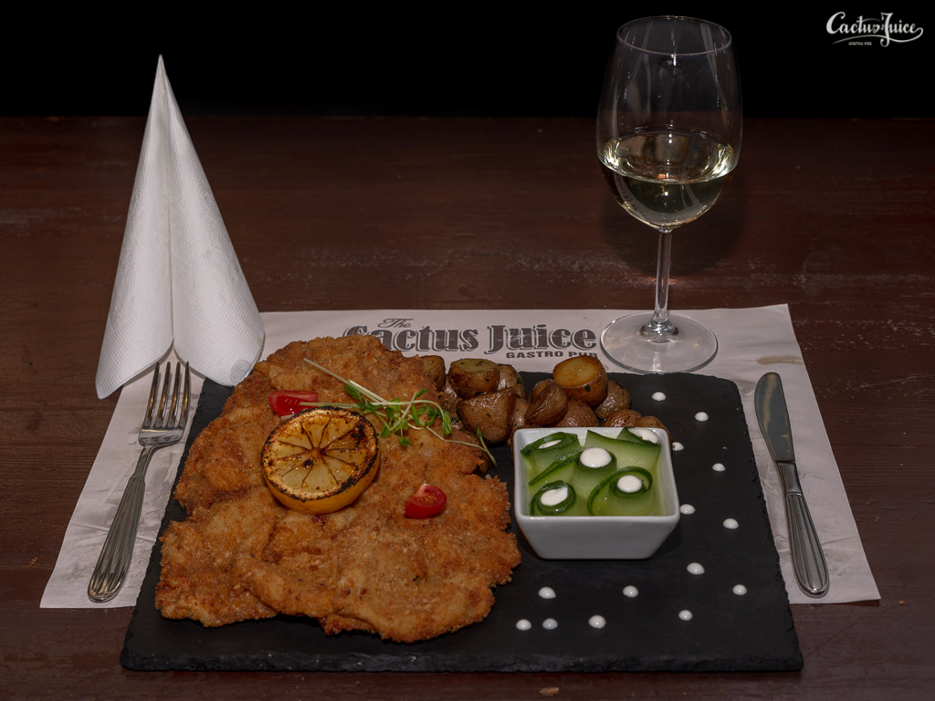 Wiener Schnitzel with parsley potatoes and cucumber salad with sour cream