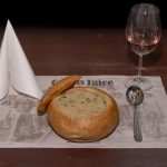 Creamy onion soup served in bread loaf